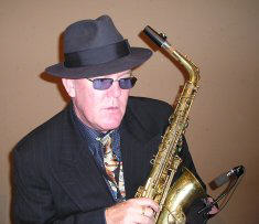 head and shoulders of Johnny Hooper with saxaphone